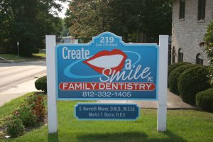 Create A Smile, PC - Dr. Ken Moore, a dental practice located in Bloomington that offers teeth implants, including denture implants.